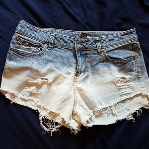 Ombre bleached distressed ripped jean shorts